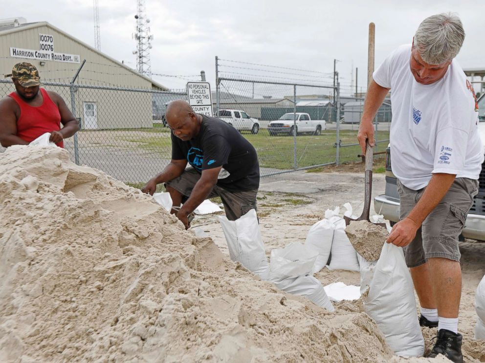 PHOTO: Gulfport, Mississippi, shoveling sand into bags at a Harrison County Road Department's sand processing facility as they prepare for subtropical storm Alberto to make their way through the Gulf of Mexico on May 26, 2018.