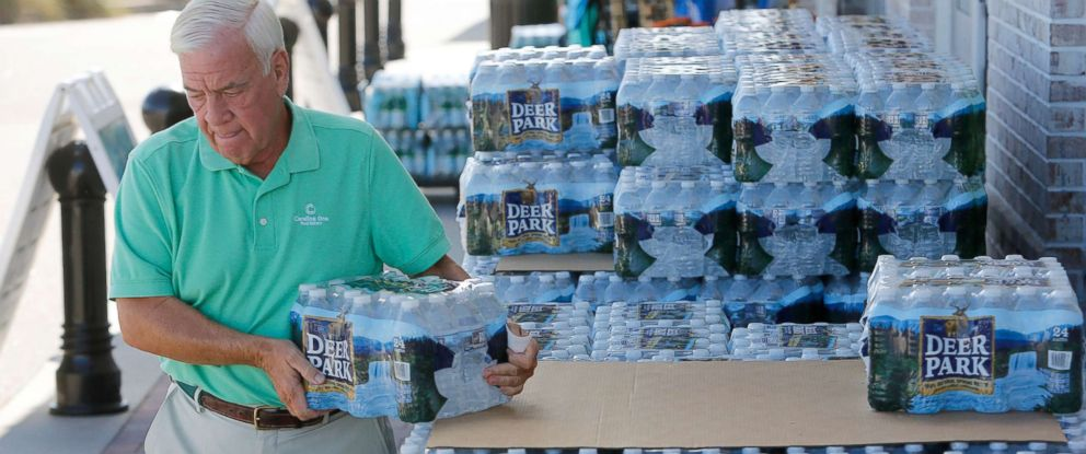 PHOTO: Larry Pierson, from the Isle of Palms, S.C., purchases bottled water from the Harris Teeter grocery store on the Isle of Palms in preparation for Hurricane Florence at the Isle of Palms S.C., Sept. 10, 2018.
