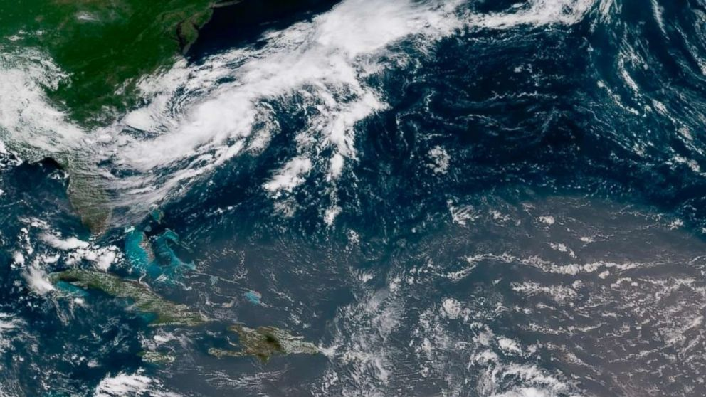 In this geocolor image GOES-16 satellite image taken July 8, 2018, at 15:00 UTC, shows Tropical Storm Beryl, center right, moving across the Lesser Antilles in the eastern Caribbean Sea, and Tropical Storm Chris, top left, off the U.S. East Coast.