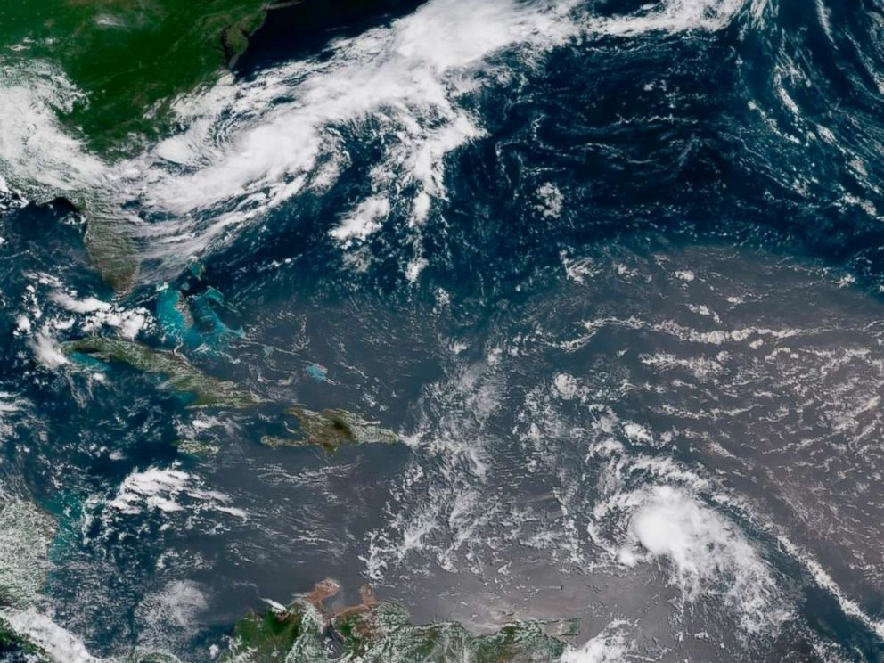 PHOTO: In this geocolor image GOES-16 satellite image taken July 8, 2018, at 15:00 UTC, shows Tropical Storm Beryl, center right, moving across the Lesser Antilles in the eastern Caribbean Sea, and Tropical Storm Chris, top left, off the U.S. East Coast.
