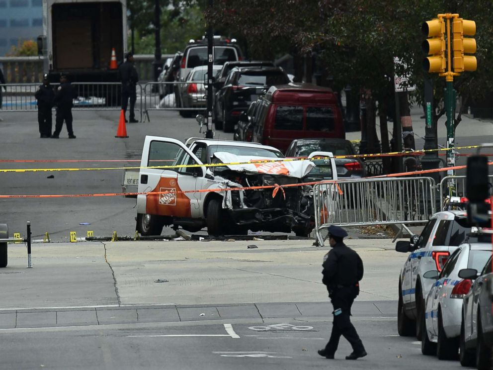 PHOTO: A police officer walks past the wreckage of a Home Depot pickup truck, a day after it was used in an terror attack, in New York City, Nov. 1, 2017.