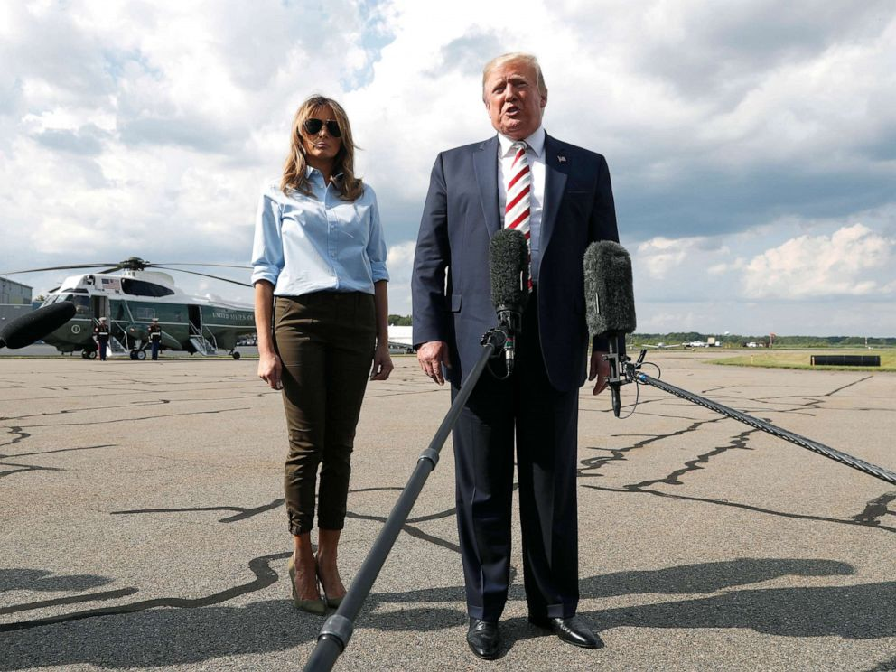 PHOTO: President Donald Trump, with first lady Melania Trump, speaks to the media before boarding Air Force One in Morristown, N.J., Aug. 4, 2019.