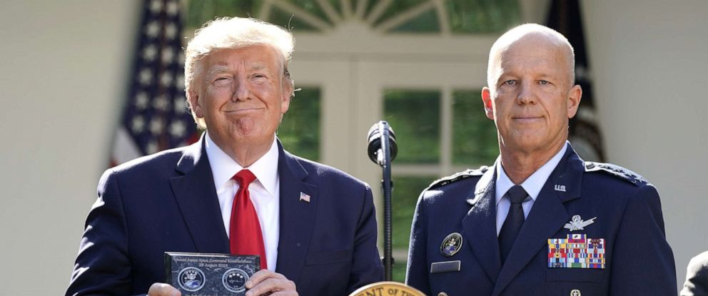 PHOTO: President Donald Trump stands with General John Raymond, incoming U.S. Space Command commander, during an event to officially launch the United States Space Command in the Rose Garden of the White House, Aug. 29, 2019