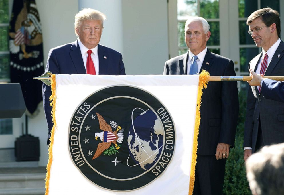 PHOTO:President Donald Trump stands behind a U.S. Space Command flag with Vice President Mike Pence and Defense Secretary Mark Esper at an event to officially launch the United States Space Command in the Rose Garden of the White House, Aug. 29, 2019.