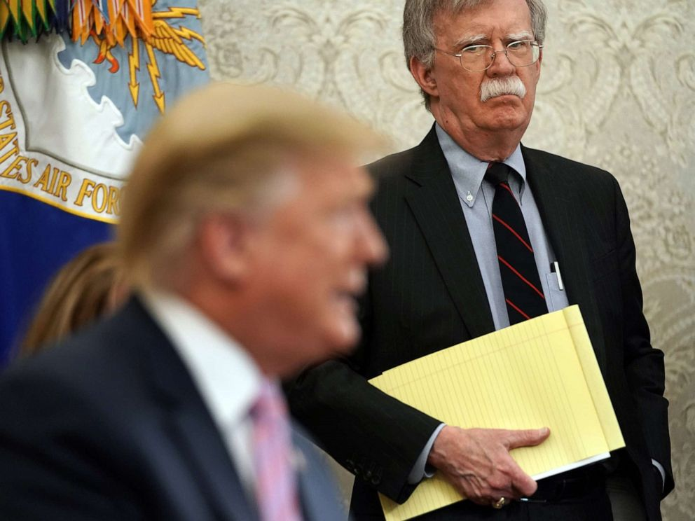 John Bolton listens to U.S. President Donald Trump speak in the Oval Office of the White House