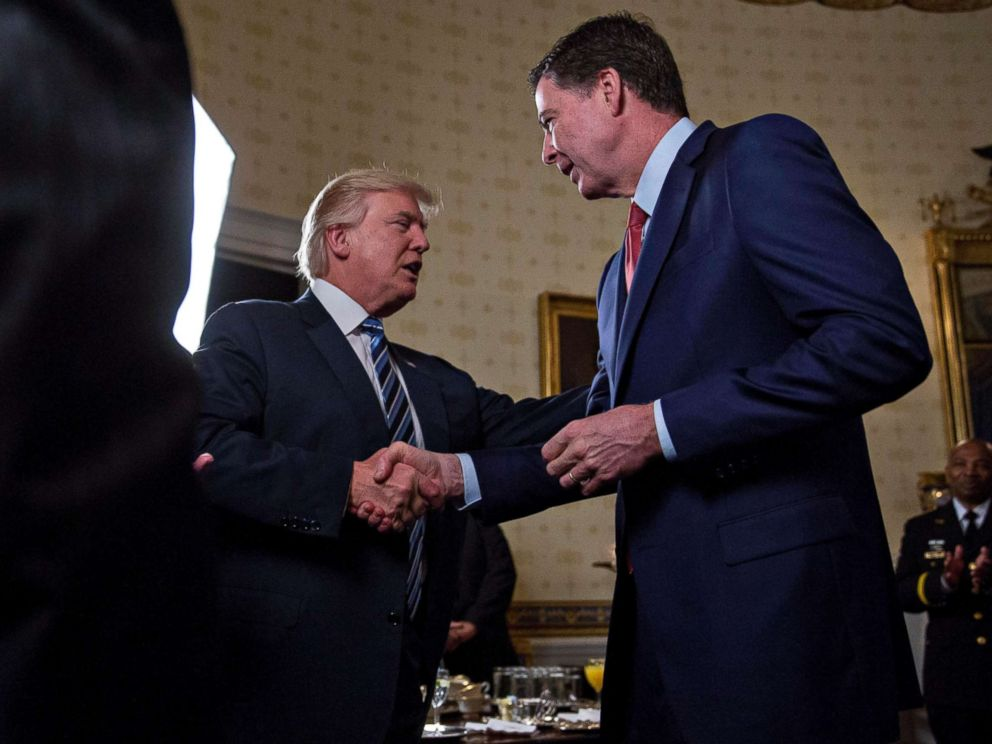 PHOTO: Donald Trump shakes hands with James Comey, during an Inaugural Law Enforcement Officers and First Responders Reception, Jan. 22, 2017, in Washington.