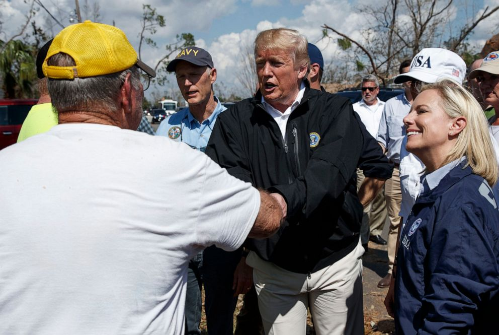 PHOTO: President Donald Trump greets a Lynn Haven, Fla. resident, left, during a tour of a neighborhood hit by Hurricane Michael, Oct. 15, 2018, in Lynn Haven, Fla.