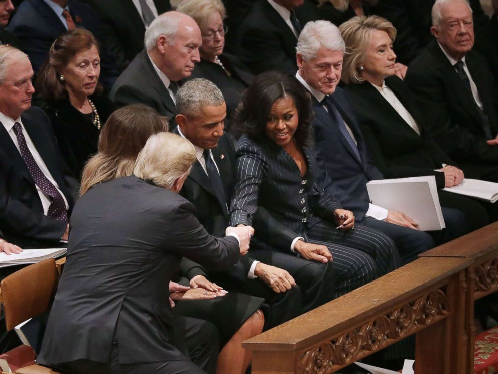PHOTO: President Donald Trump and first lady Melania Trump greet former President Barack Obama and Michelle Obama, joining other former presidents and their spouses for the state funeral for former President George H.W. Bush, Dec. 5, 2018 in Washington.