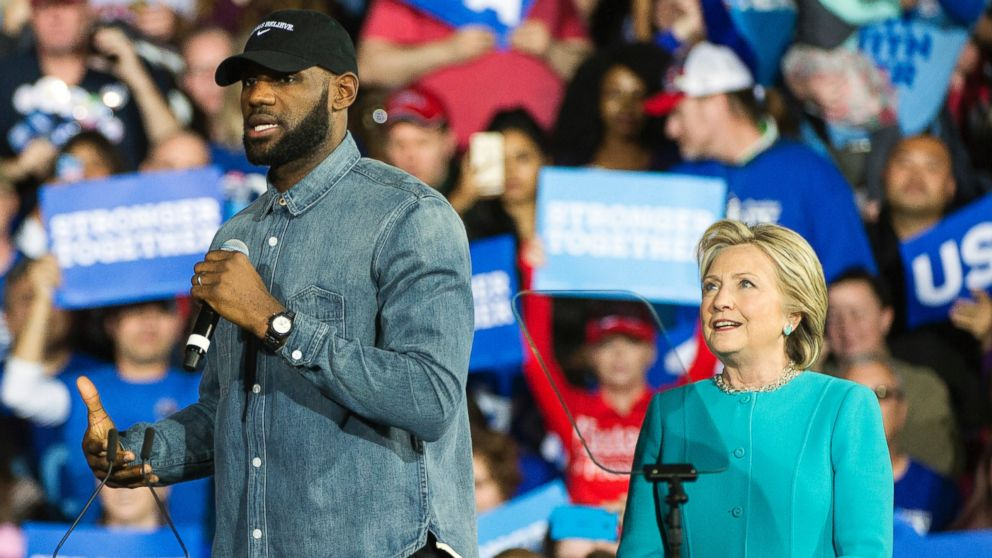 Cleveland Cavaliers star LeBron James speaks as Democratic presidential candidate Hillary Clinton listens during a campaign stop at Cleveland Public Hall in Cleveland, Sunday, Nov. 6, 2016.