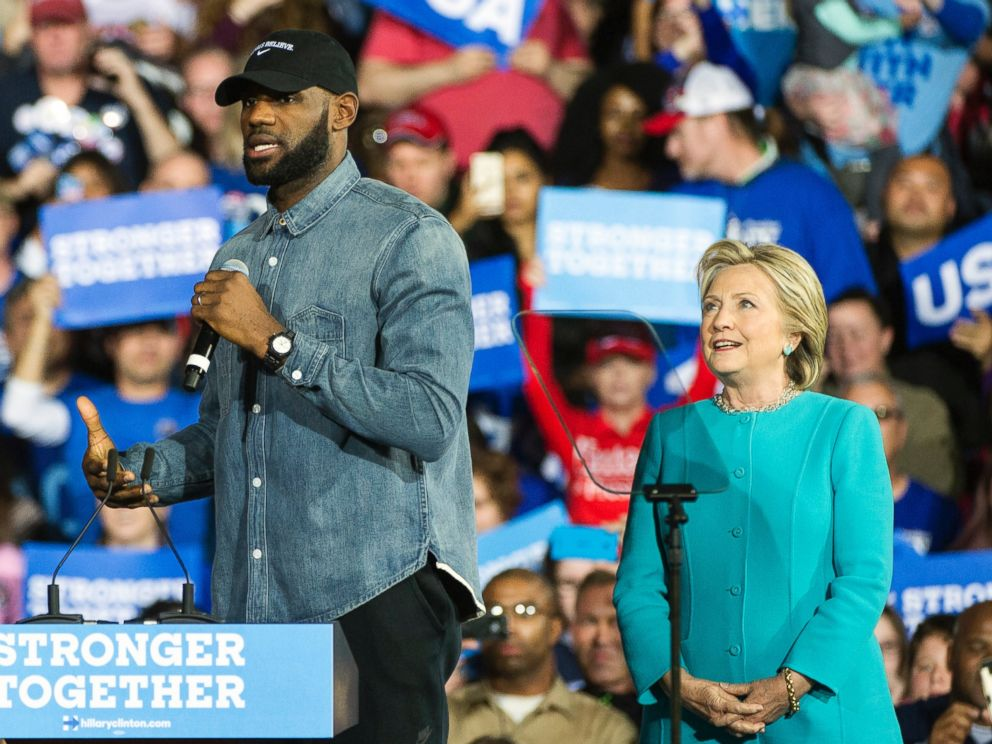 Cleveland Cavaliers star Le Bron James speaks as Democratic presidential candidate Hillary Clinton listens during a campaign stop at Cleveland Public Hall in Cleveland Sunday Nov. 6 2016