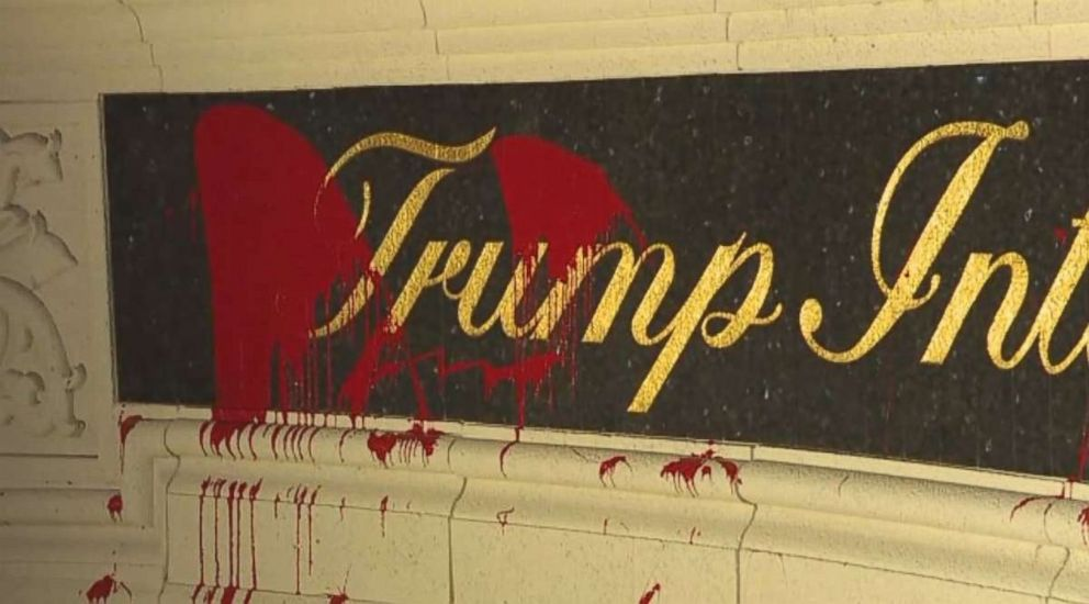 Red paint was splattered on the entrance sign at Trump International Golf Club in West Palm Beach, Florida, on Saturday, March 31, 2018.