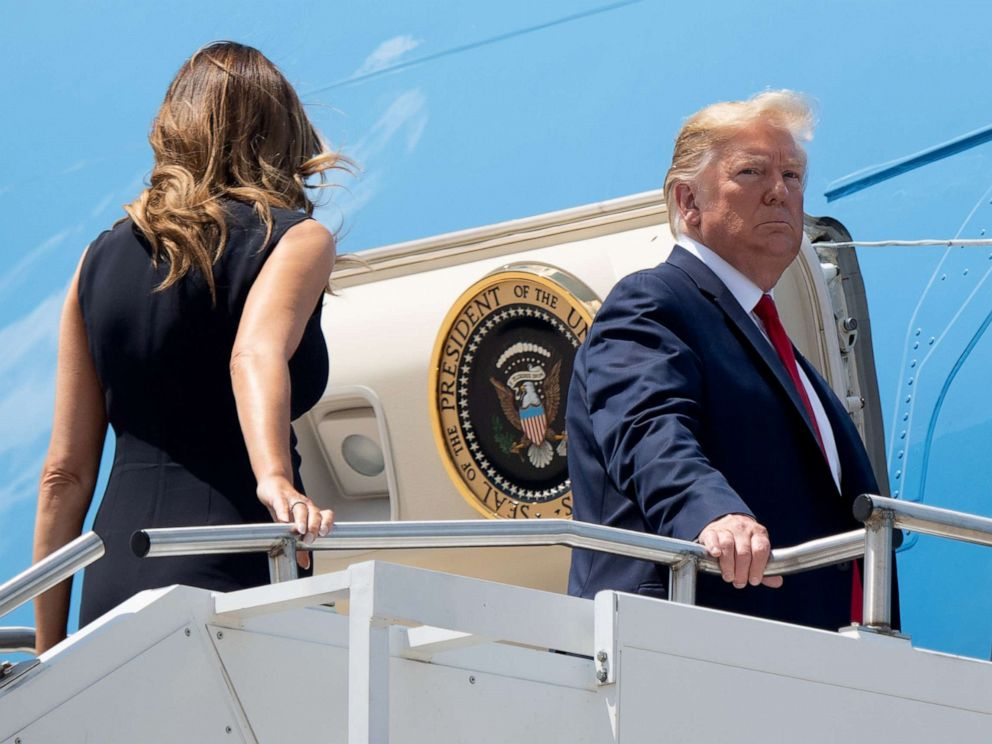 PHOTO: President Donald Trump, with first lady Melania Trump, boards Air Force One at Wright-Patterson Air Force Base in Ohio, Aug. 7, 2019.