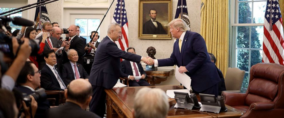 PHOTO: President Donald Trump shakes hands with Chinese Vice Premier Liu He in the Oval Office at the White House, Oct. 11, 2019, in Washington, DC.
