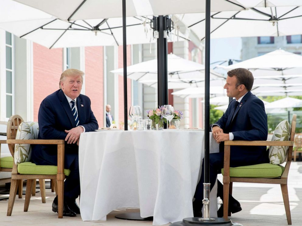 PHOTO: U.S President Donald Trump sits for lunch with French President Emmanuel Macron, right, at the Hotel du Palais in Biarritz, south-west France, Saturday Aug. 24, 2019.
