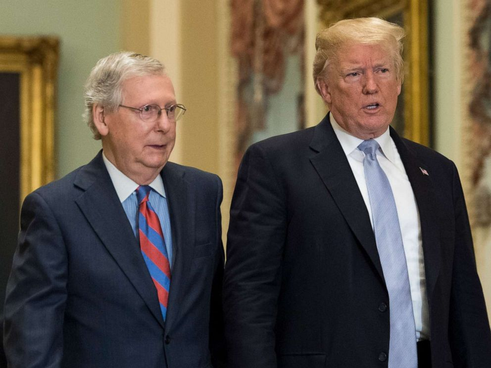 PHOTO: President Donald Trump walks with Senate Majority Leader Mitch McConnell at the Capitol on May 15, 2018, in Washington.
