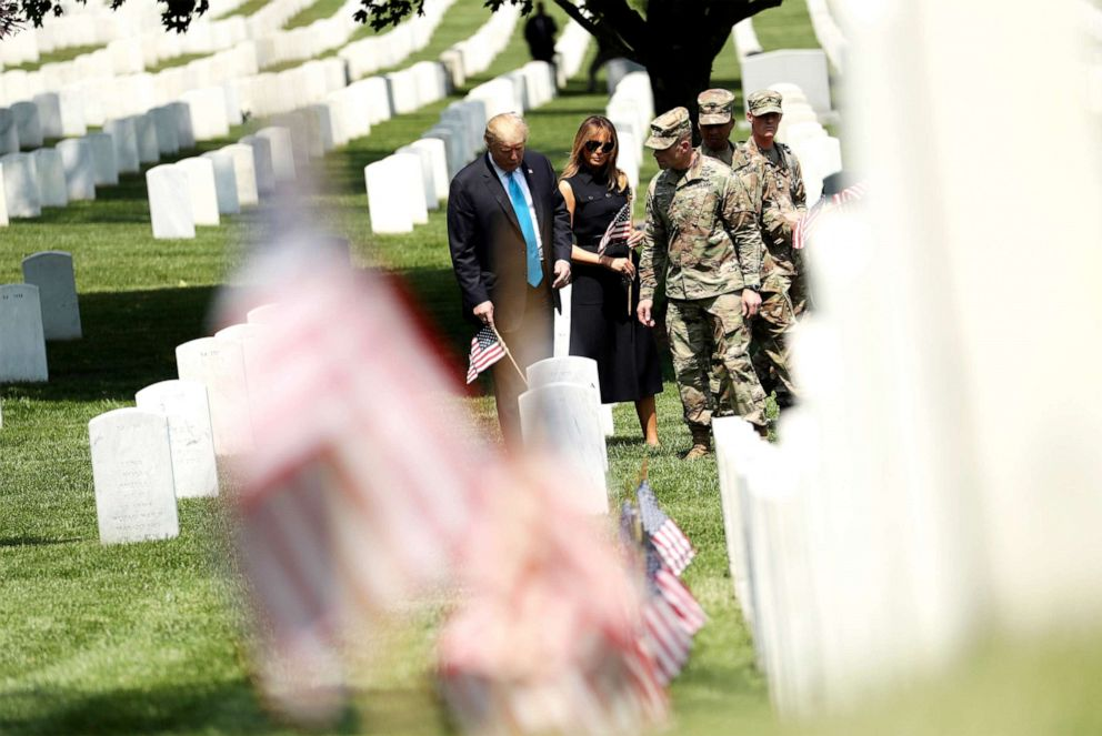 PHOTO: President Donald Trump and first lady Melania Trump visit Arlington National Cemetery for the annual Flags In ceremony ahead of Memorial Day Thursday, May 23, 2019, in Arlington, Va.