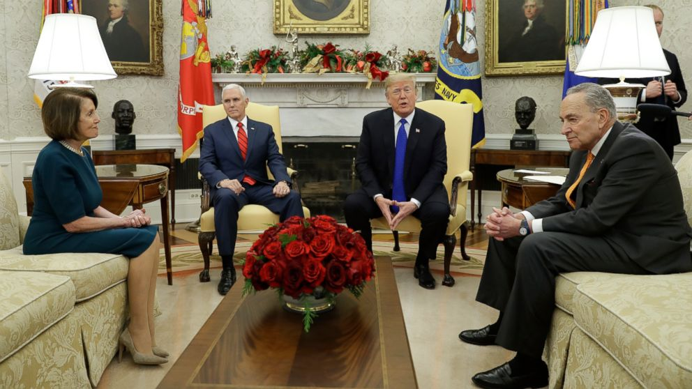 President Donald Trump and Vice President Mike Pence meet with Senate Minority Leader Chuck Schumer and House Minority Leader Nancy Pelosi in the Oval Office of the White House, Dec. 11, 2018, in Washington.