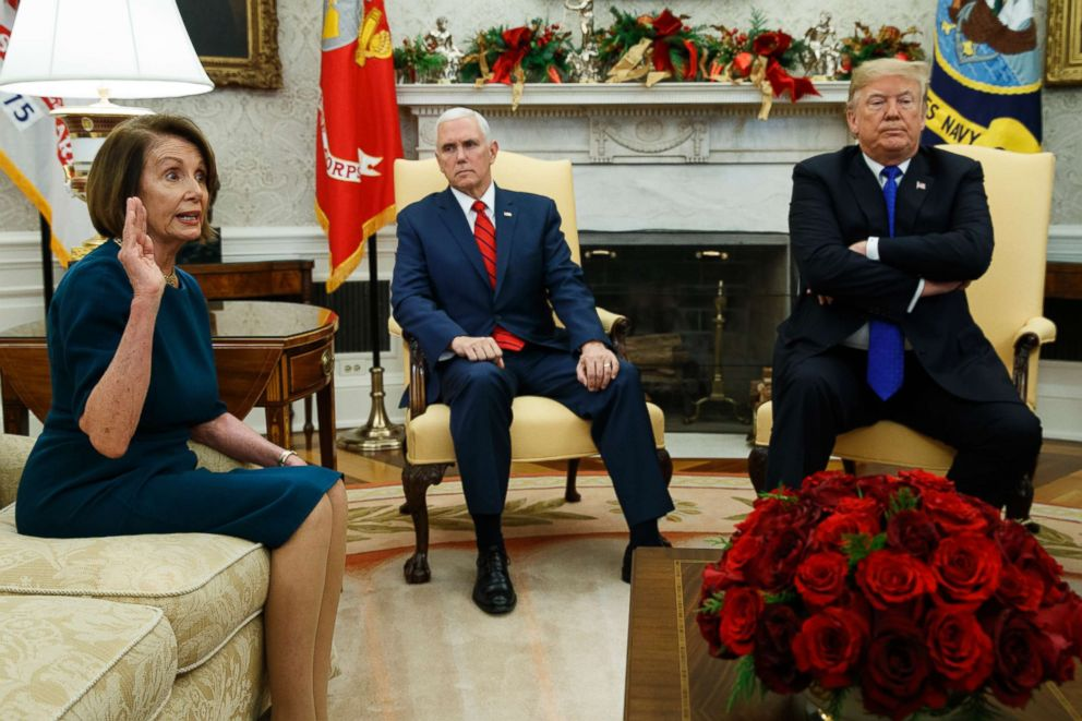 PHOTO: Vice President Mike Pence listens as President Donald Trump argues with House Minority Leader Rep. Nancy Pelosi during a meeting in the Oval Office of the White House, Dec. 11, 2018, in Washington.