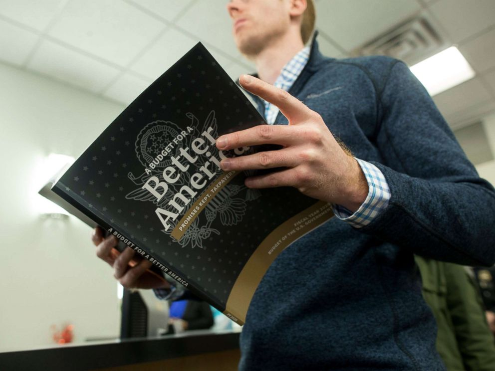 PHOTO: A member of the public waits in line to purchase a copy of President Donald Trumps budget for the fiscal year 2020, at its release at the Government Publishing Office bookstore in Washington, March 11, 2019.