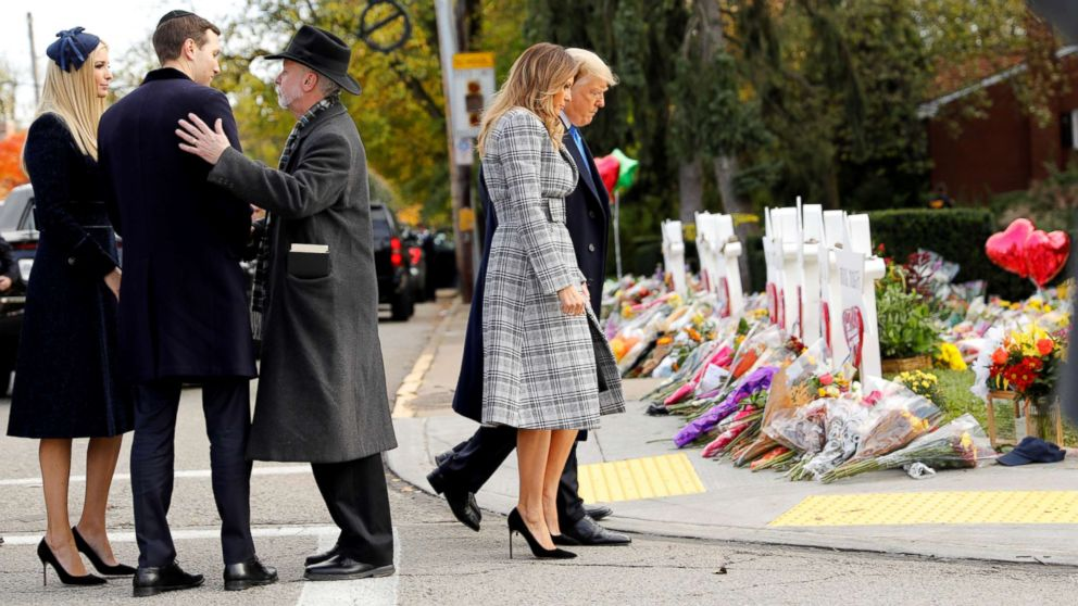 White House senior advisers Jared Kushner and Ivanka Trump speak with Rabbi Jeffrey Myers as President Donald Trump and first lady Melania Trump pay their respects outside the Tree of Life synagogue in the wake of the shooting at the synagogue where 11 people were killed and six people were wounded in Pittsburgh, Pennsylvania, Oct. 30, 2018.