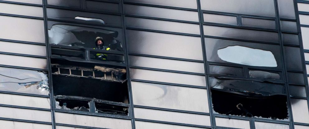 PHOTO: A firefighter looks out from the window of a damaged apartment in Trump Tower in New York, April 7, 2018. The New York Fire Department says the blaze broke out on the 50th floor shortly before 6 p.m. Saturday.