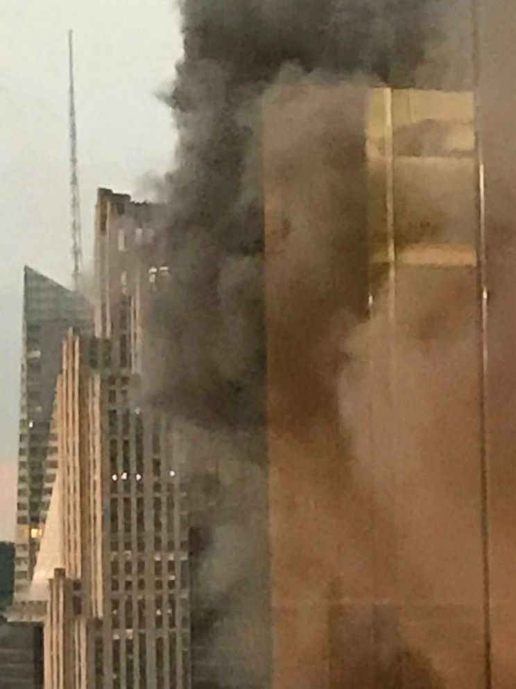 PHOTO: Clouds of dark smoke emanated from the Trump Towers rooftop, Jan. 8, 2018, in New York.