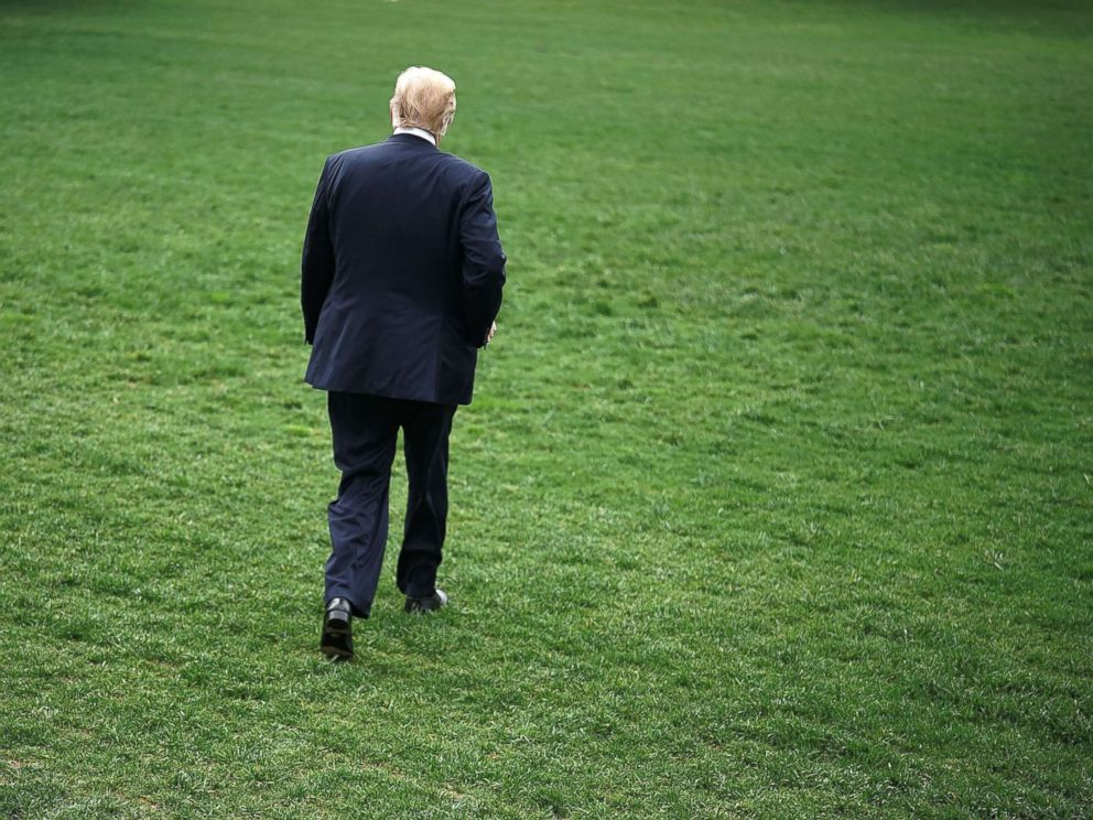 PHOTO: President Donald Trump walks across the South Lawn of the White House in Washington, DC on May 4, 2018