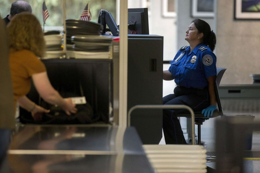 PHOTO: In this file photo, a Transportation Security Administration (TSA) officer operates an x-ray machine in the TSA pre-check area at Dulles International Airport in Dulles, Virginia, U.S., Aug. 19, 2015.