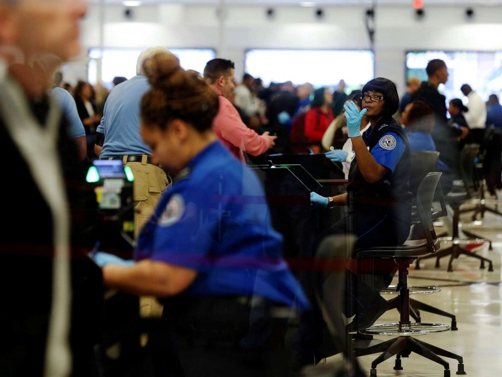 PHOTO: Transportation Security Administration (TSA) agents screen passengers at a security checkpoint at Hartsfield-Jackson Atlanta International Airport, Jan. 18, 2019.