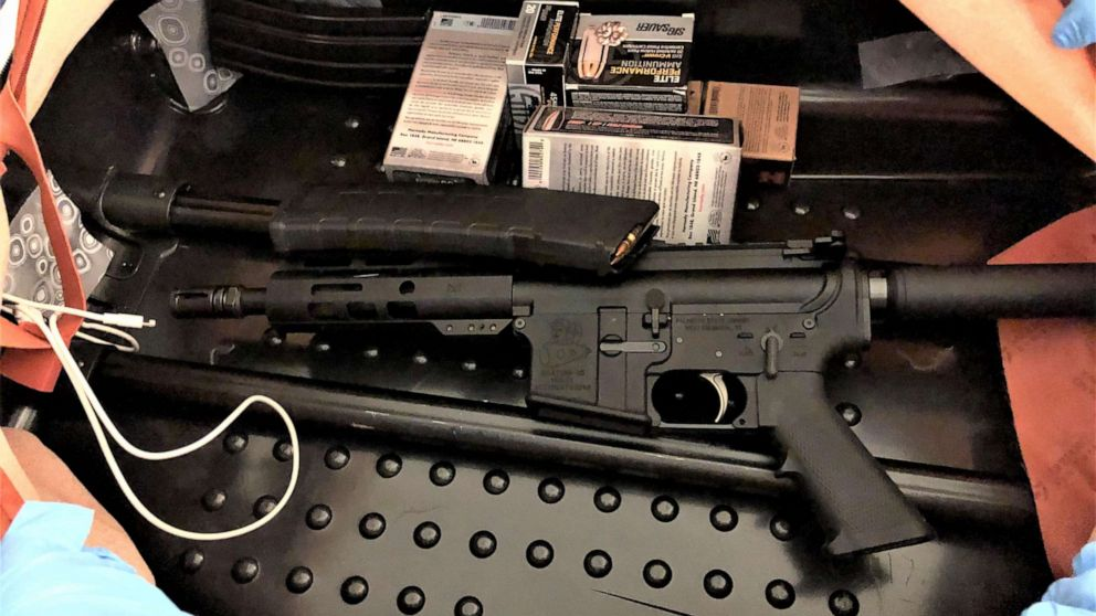 PHOTO: TSA officials released this image with a press release stating that officers at Newark Liberty International Airport found this assault rifle and ammunition concealed in the lining of a traveler's suitcase on July 20, 2020.