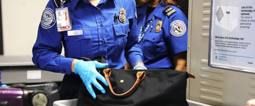 PHOTO: A Transportation Security Administration (TSA) worker screens luggage at LaGuardia Airport (LGA) on Sept. 26, 2017, in New York City.