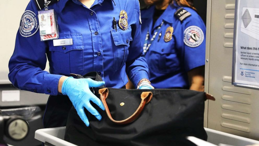 A Transportation Security Administration (TSA) worker screens luggage at LaGuardia Airport (LGA) on Sept. 26, 2017, in New York City.