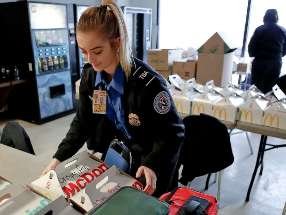 PHOTO: TSA officer Jenna Erickson, left, helps arrange boxes of meals at the TSA break room, Jan. 18, 2019, at the Pittsburgh International Airport in Imperial, Pa.