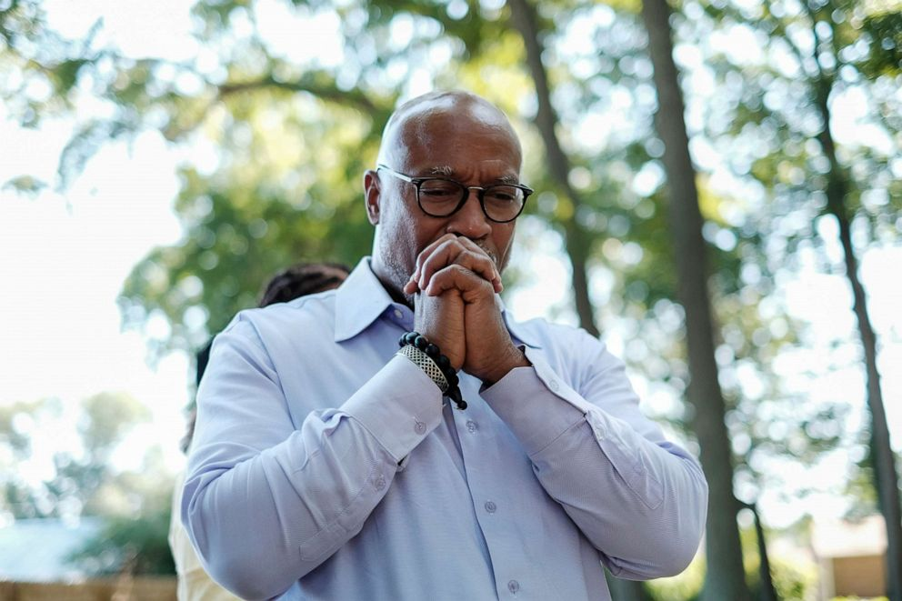 PHOTO: Verrandall S.Tucker, a descendent of William Tucker, pays respects to a family member buried at the Tucker family cemetery in Hampton, Virginia, July 27, 2019.