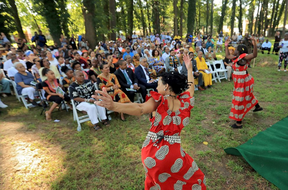 PHOTO: Members of the music and dance group Atumpan perform traditional African dances at the Tucker Family Cemetery in Hampton, Va., Aug. 23, 2019.