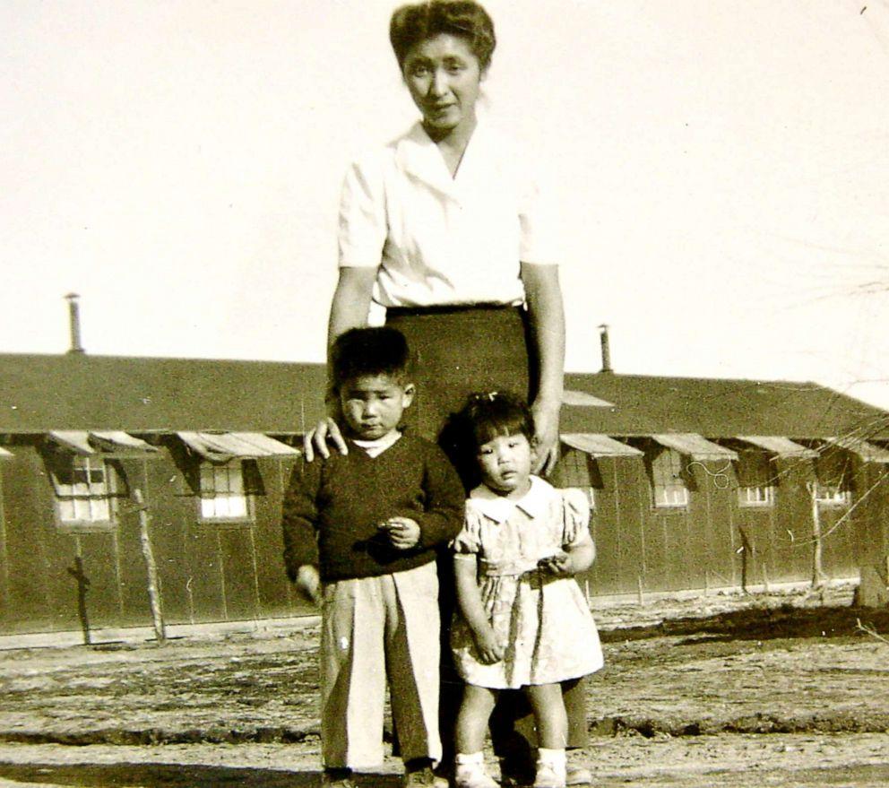 PHOTO: Shizuko Ina, Kiyoshi Ina and Satsuki Ina in Tule Lake after their father was taken and incarcerated in North Dakota. Photo taken at Tule Lake Segregation Center, Ca., 1945.
