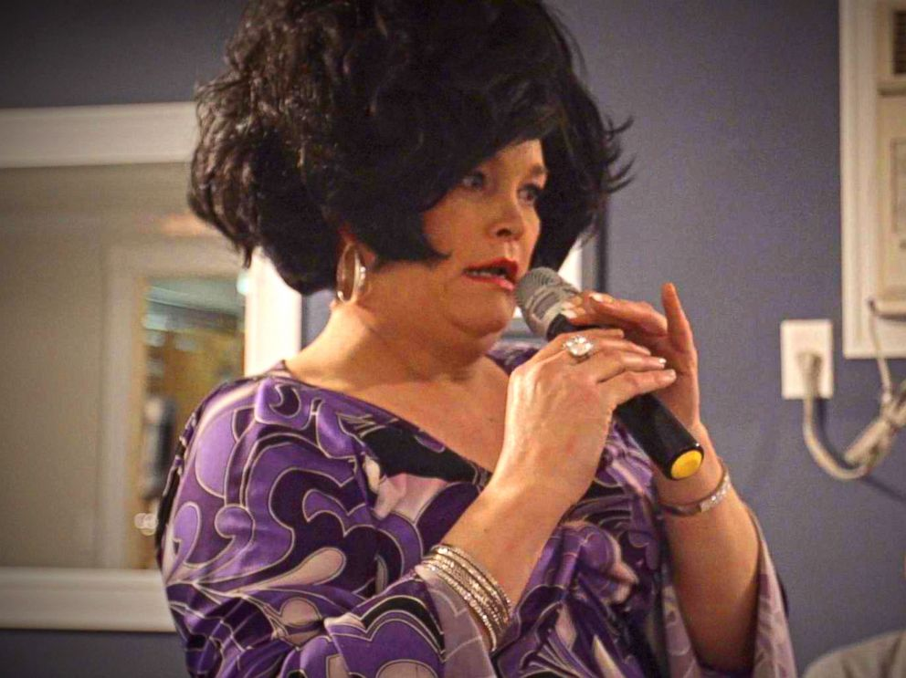 PHOTO: Jennifer Bobbi pictured hosting a Tupperware party as the character of Aunt Barbara in Patchogue, NY.