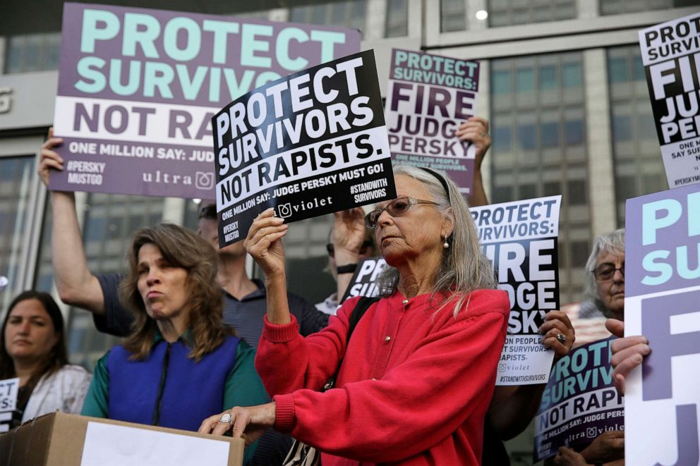 PHOTO: Activists from UltraViolet hold up signs before delivering over one million signatures to the California Commission on Judicial Performance calling for the removal of Judge Aaron Persky from the bench at a rally in San Francisco, June 10, 2016.