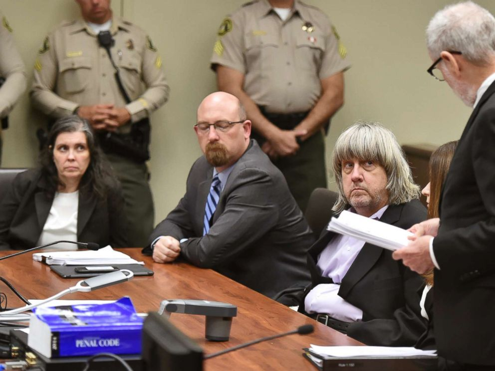 PHOTO: Louise Anna Turpin, far left, with attorney Jeff Moore, center, and her husband David Allen Turpin, listen to attorney, David Macher, as they appear in court for their arraignment in Riverside, Calif., Jan. 18, 2018.