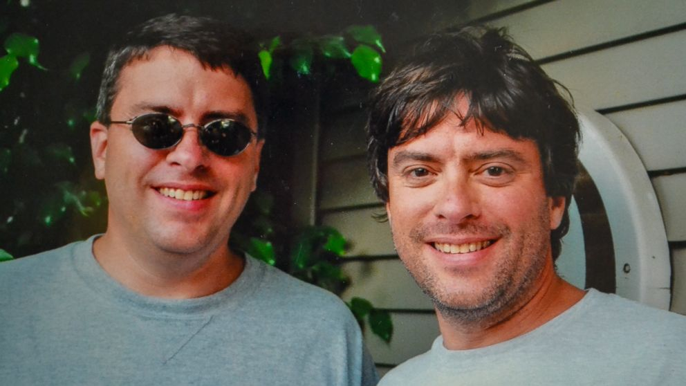 Twin brothers Howard Burack, left, and Doug Rausch were separated at birth and finally reunited at an airport in Columbus, Ohio.