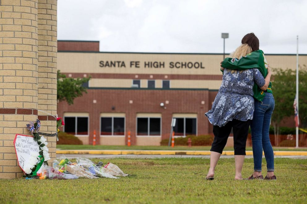 PHOTO: Senior Amy Roden and her grandmother Gail embrace at a makeshift memorial for shooting victims outside Santa Fe High School in Santa Fe, Texas, May 20, 2018.