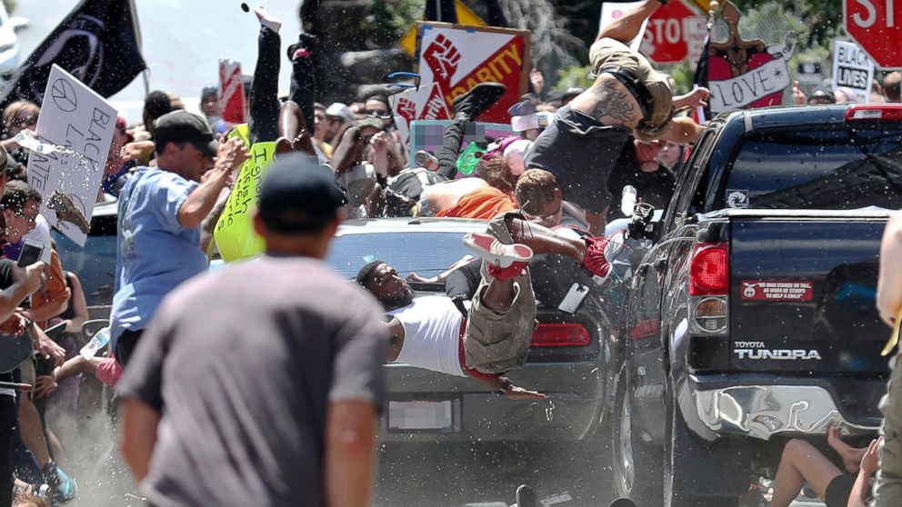 People fly into the air as a vehicle drives into a group of protesters demonstrating against a white nationalist rally in Charlottesville, Va., Aug. 12, 2017. The nationalists were holding the rally to protest plans by the city of Charlottesville to remove a statue of Confederate Gen. Robert E. Lee. There were several hundred protesters marching in a long line when the car drove into a group of them.