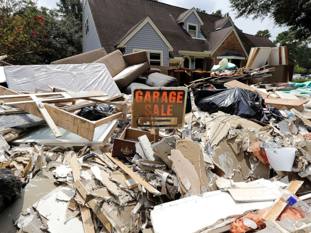 PHOTO: A garage sale sign stands in a pile of debris damaged by floodwaters in the aftermath of Hurricane Harvey in Spring, Texas, Sept. 3, 2017.
