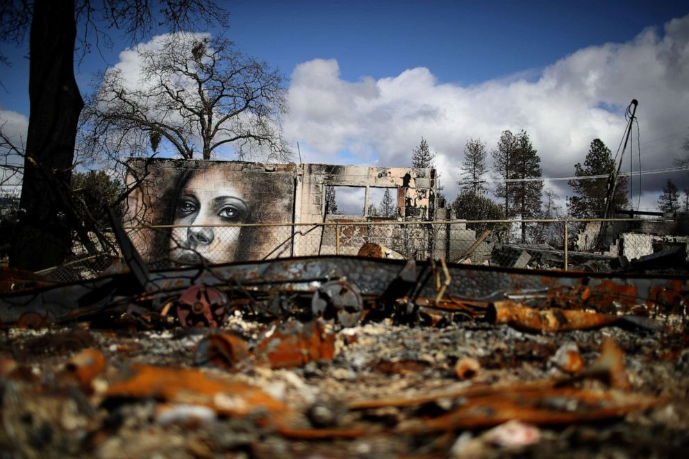 PHOTO: A mural by artist Shane Grammer is visible on the wall of a building destroyed by the Camp Fire on Feb. 11, 2019 in Paradise, Calif.