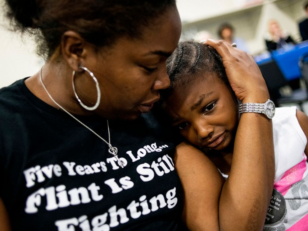 PHOTO: Flint resident Ariana Hawk consoles her daughter Aliana, 4, near the end of a two-hour community meeting with Flint water prosecutors at UAW Local 659, June 28, 2019, in Flint, Michigan.