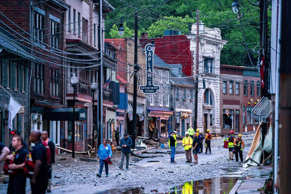 PHOTO: Rescue personnel examine damage on Main Street after a flash flood rushed through the historic town of Ellicott City, Maryland, May 27, 2018. The National Weather Service stated as much as 9.5 inches of rain fell in the area.
