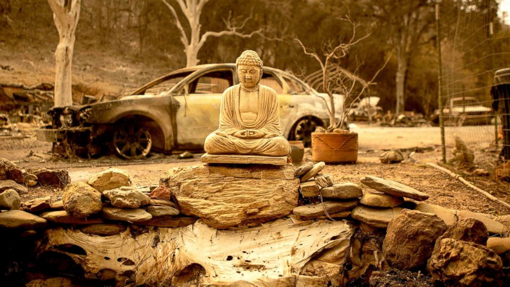 A statue of the Buddha is seen at a burned home near Clearlake Oaks, California, Aug. 7, 2018. The raging Mendocino Complex fire comprising twin blazes in the western state's north has now ravaged more than 290,000 acres.