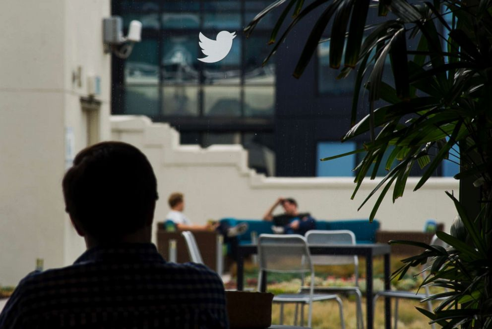 PHOTO: An employee is seen beneath the Twitter Inc. logo in the cafeteria area of the companys headquarters in San Francisco, Calif., Sept. 19, 2014.