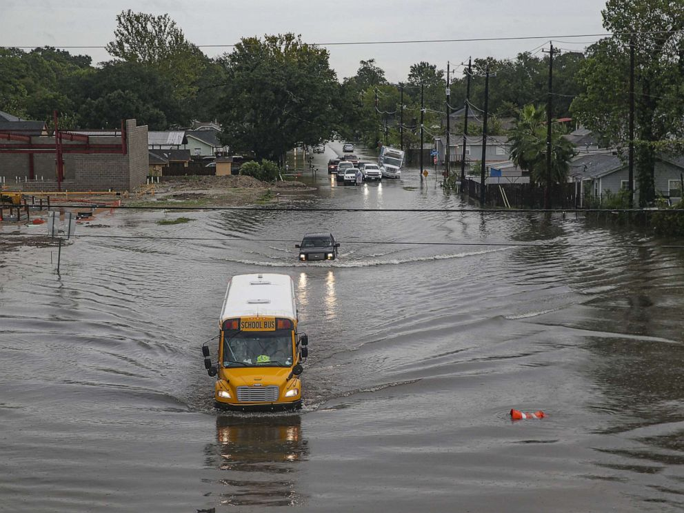 PHOTO: HOUSTON, TX - SEPTEMBER 19: A school bus makes its way on the flooded Hopper Rd. on September 19, 2019 in Houston, Texas.