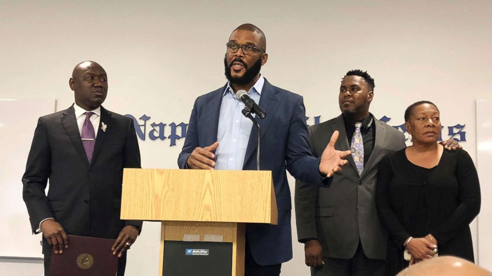 Filmmaker Tyler Perry, center, speaks to a a press conference announcing a lawsuit against former Collier County Sheriff's Deputy Steven Calkins, Sept. 4, 2018 in Naples, Fla.